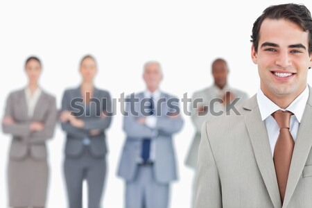 Smiling salesman with his team behind him against a white background Stock photo © wavebreak_media