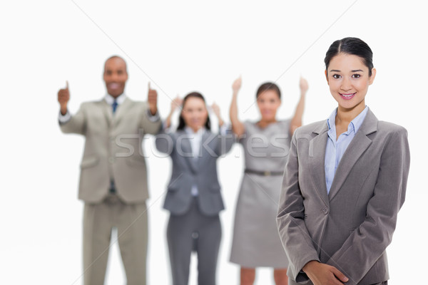 Close-up of a businesswoman smiling with co-workers approving in the background Stock photo © wavebreak_media