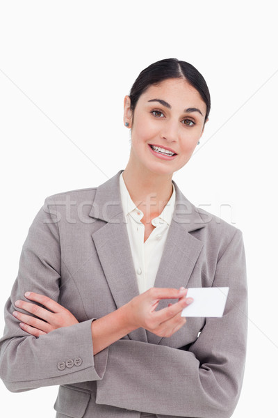 Saleswoman with arms folded and business card against a white background Stock photo © wavebreak_media