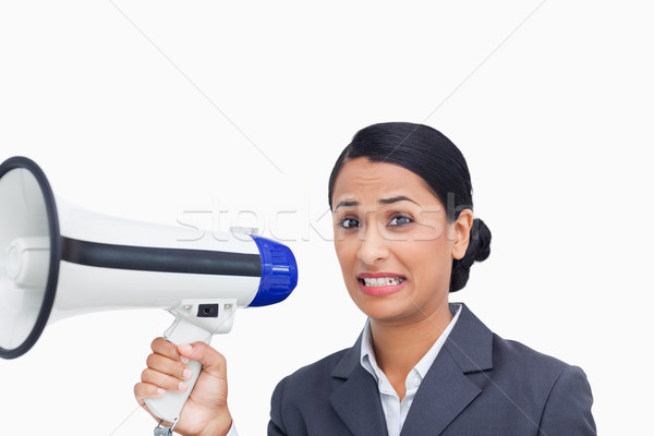 Close up of afraid saleswoman with megaphone against a white background Stock photo © wavebreak_media