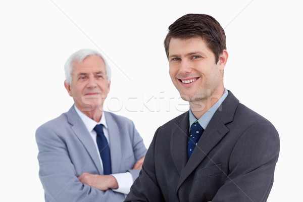 Close up of smiling businessman with his mentor behind him against a white background Stock photo © wavebreak_media