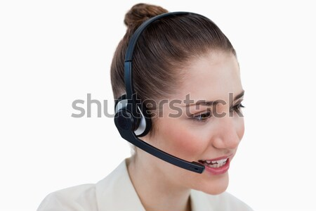 Stock photo: Close up of an operator talking through a headset against a white background