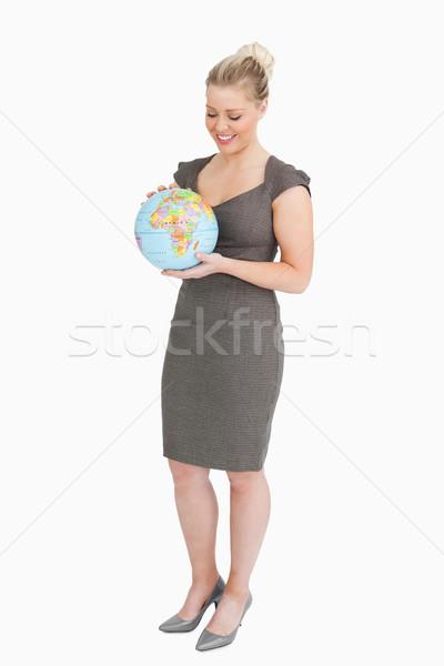 Empresária olhando globo mãos branco cidade Foto stock © wavebreak_media