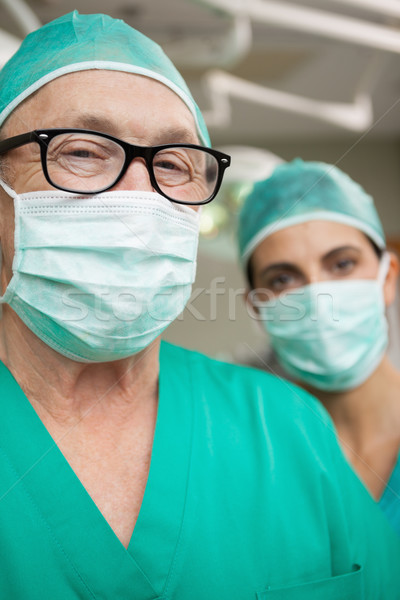 man surgeon with glasses and a colleague in a surgical room Stock photo © wavebreak_media