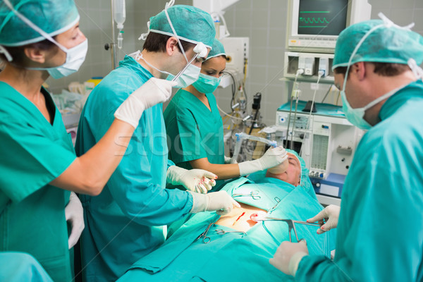 Nurse drying the forehead of a surgeon in an operating theatre Stock photo © wavebreak_media