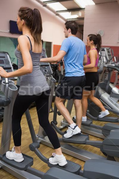Három ember képzés lépés gépek tornaterem sport Stock fotó © wavebreak_media