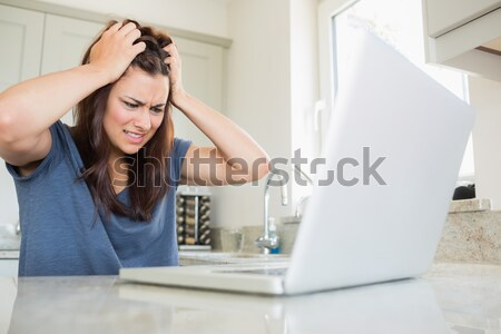 Woman getting frustrated over bills in kitchen Stock photo © wavebreak_media