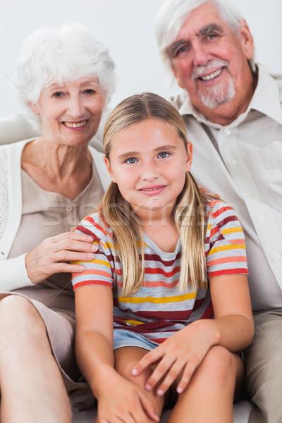 внучка дедушка и бабушка диван улыбаясь дома девушки Сток-фото © wavebreak_media