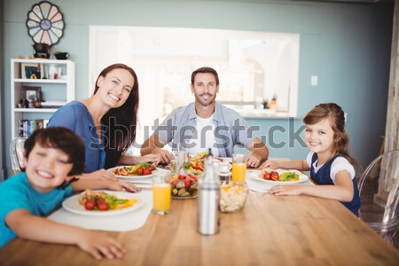 Family laughing around a good meal Stock photo © wavebreak_media