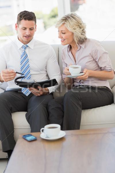 üzletember titkárnő napló teáscsésze okos kanapé Stock fotó © wavebreak_media