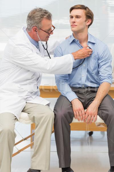 Doktor dinleme göğüs stetoskop ofis hastane Stok fotoğraf © wavebreak_media