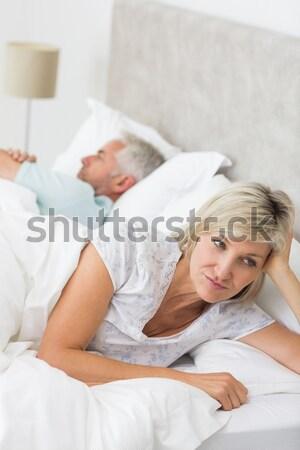 Kobieta dojrzały mężczyzna bed domu domu walki Zdjęcia stock © wavebreak_media
