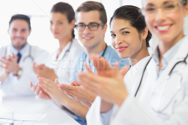 Confident nurse and doctors applauding Stock photo © wavebreak_media