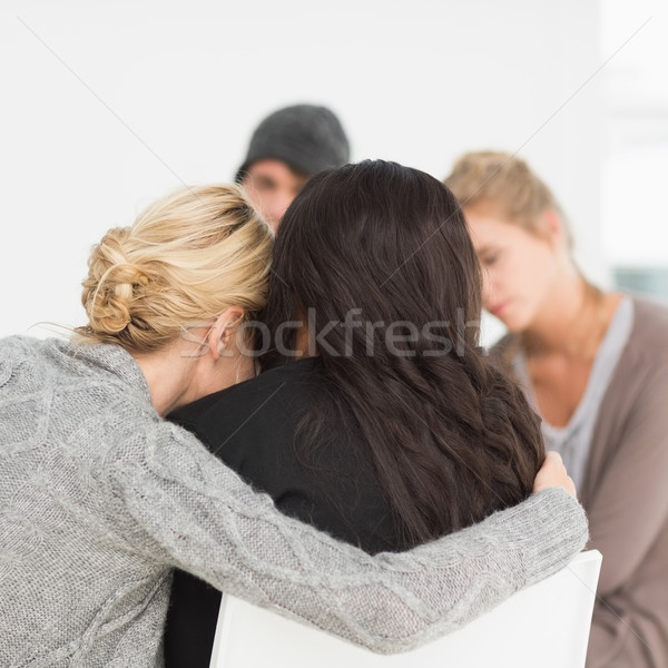 Women hugging in rehab group Stock photo © wavebreak_media