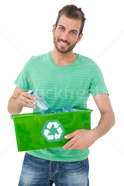 Portrait souriant jeune homme recycler contenant Photo stock © wavebreak_media
