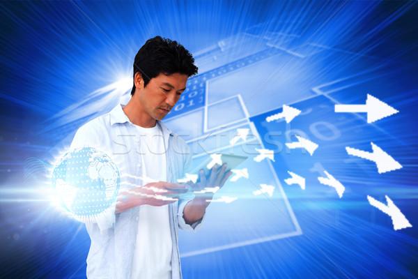 Przypadkowy człowiek tabletka digital composite niebieski Zdjęcia stock © wavebreak_media