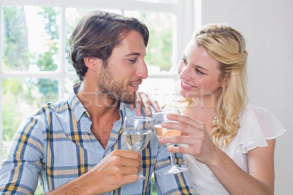Cute souriant couple vin blanc ensemble Photo stock © wavebreak_media