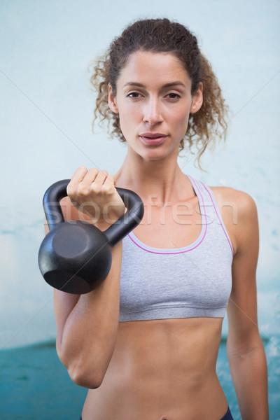 Fitt nő néz kamera tart kettlebell Stock fotó © wavebreak_media
