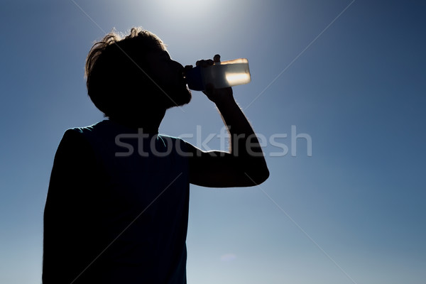 Man drinking from water bottle Stock photo © wavebreak_media