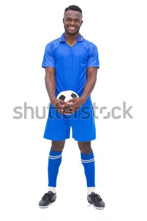 Football player in blue standing with ball Stock photo © wavebreak_media