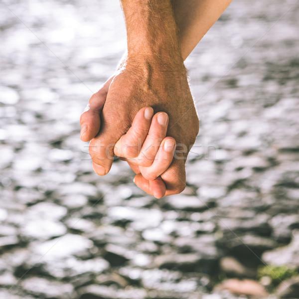 Gelukkig holding handen voorjaar man Stockfoto © wavebreak_media
