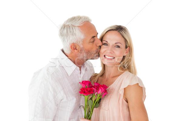 Affettuoso uomo bacio moglie guancia rose Foto d'archivio © wavebreak_media