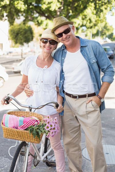 Happy mature couple going for a bike ride in the city Stock photo © wavebreak_media