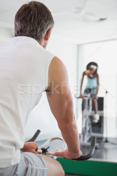 Spinning instructor motivating her class Stock photo © wavebreak_media