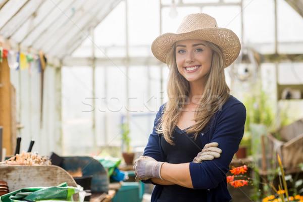 Pretty blonde smiling in greenhouse Stock photo © wavebreak_media