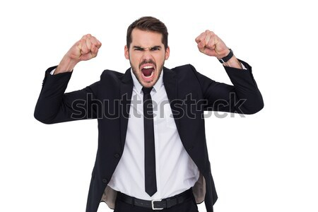 Furious businessman tensing arms muscle  Stock photo © wavebreak_media