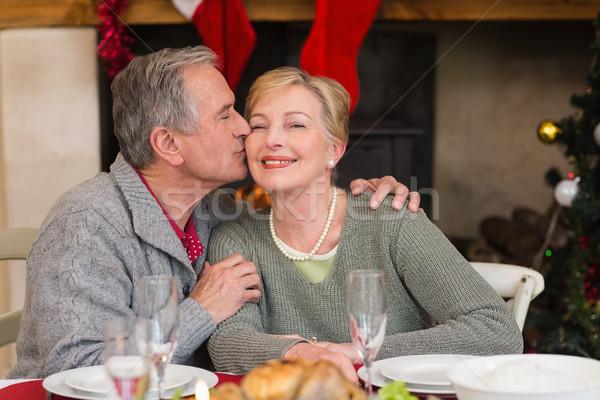 Homem maduro beijando bochecha esposa casa sala de estar Foto stock © wavebreak_media