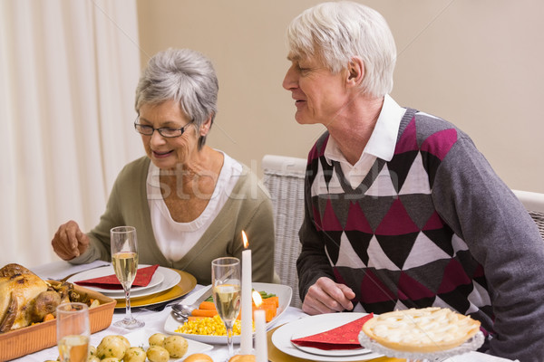 Senior citizen looking roast turkey during christmas dinner Stock photo © wavebreak_media