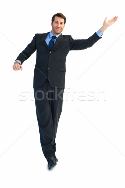 Happy businessman well dressed with arms out Stock photo © wavebreak_media