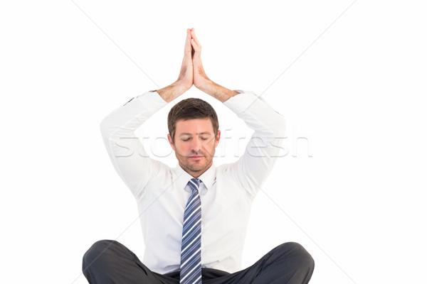 Empresário meditando lótus pose branco homem Foto stock © wavebreak_media