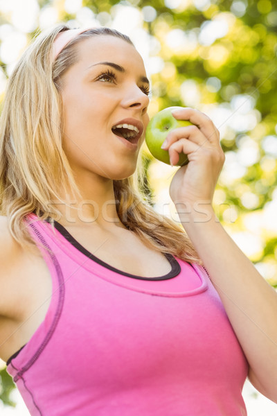 Fit blonde eating green apple Stock photo © wavebreak_media
