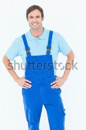Happy mechanic with hands in pockets Stock photo © wavebreak_media