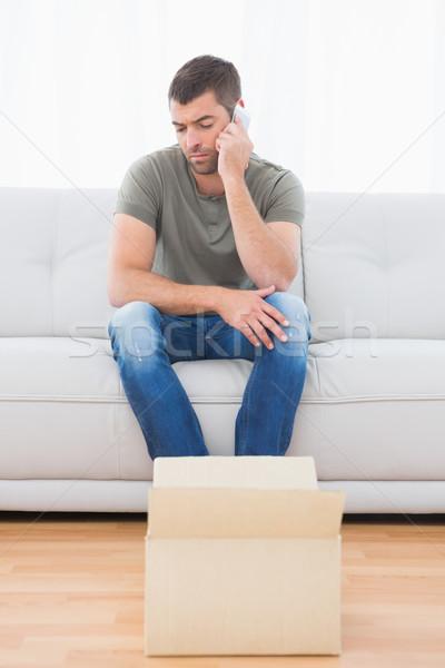 Casual man sitting in a sofa Stock photo © wavebreak_media