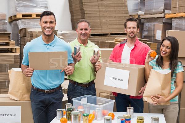 Raktár munkások csomagol felfelé adomány dobozok Stock fotó © wavebreak_media