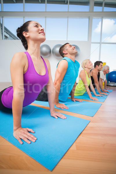 Pessoas cobra pose fitness estúdio feliz Foto stock © wavebreak_media