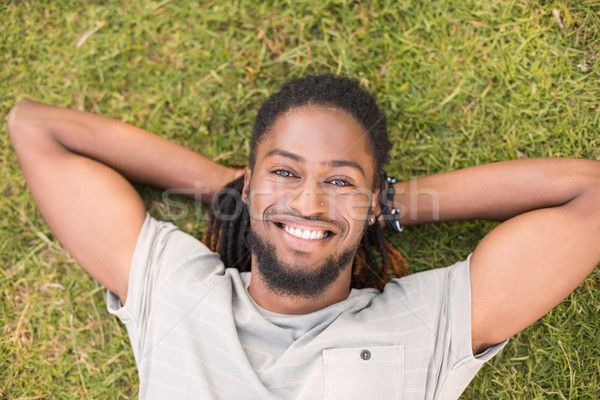 Handsome hipster relaxing in the park Stock photo © wavebreak_media