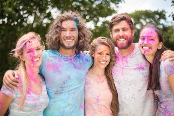 Szczęśliwy znajomych pokryty proszek farby Zdjęcia stock © wavebreak_media