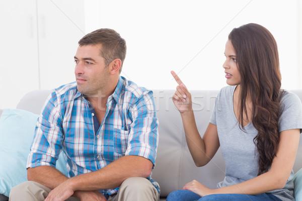 Woman arguing with man while sitting on sofa Stock photo © wavebreak_media
