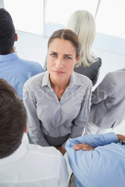 Unhappy businessman looking at camera with her colleague around  Stock photo © wavebreak_media