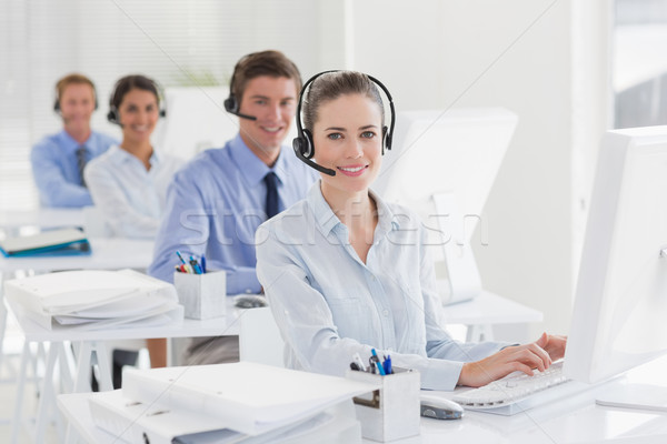 Business team working on computers and wearing headsets Stock photo © wavebreak_media