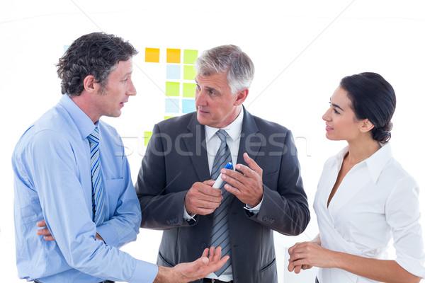 деловые люди мозговая атака вместе служба женщину бумаги Сток-фото © wavebreak_media