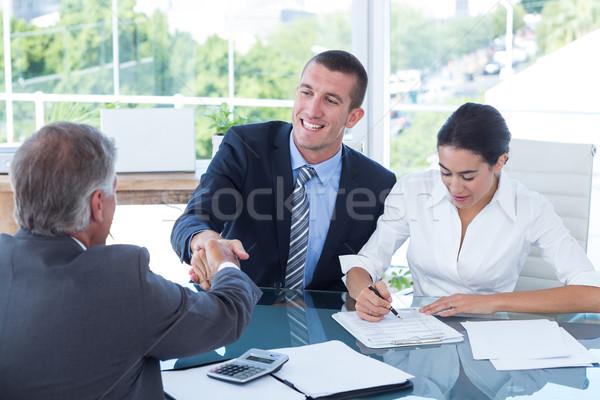 Händeschütteln Büro Frau glücklich Geschäftsleute Stock foto © wavebreak_media