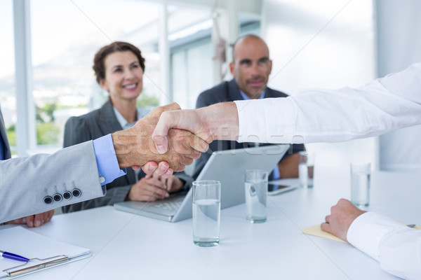 Interview panel shaking hands with applicant Stock photo © wavebreak_media