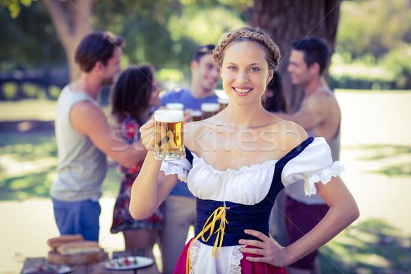 Csinos Oktoberfest szőke nő pirít park napos idő Stock fotó © wavebreak_media