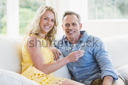 Happy couple relaxing on the couch Stock photo © wavebreak_media