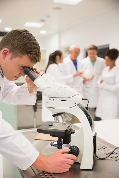Genç çalışma mikroskop üniversite adam Stok fotoğraf © wavebreak_media